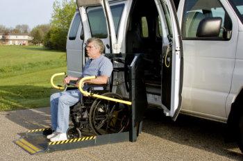 man outside on a transport van