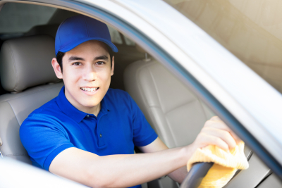 man with in a blue t-shirt smiling